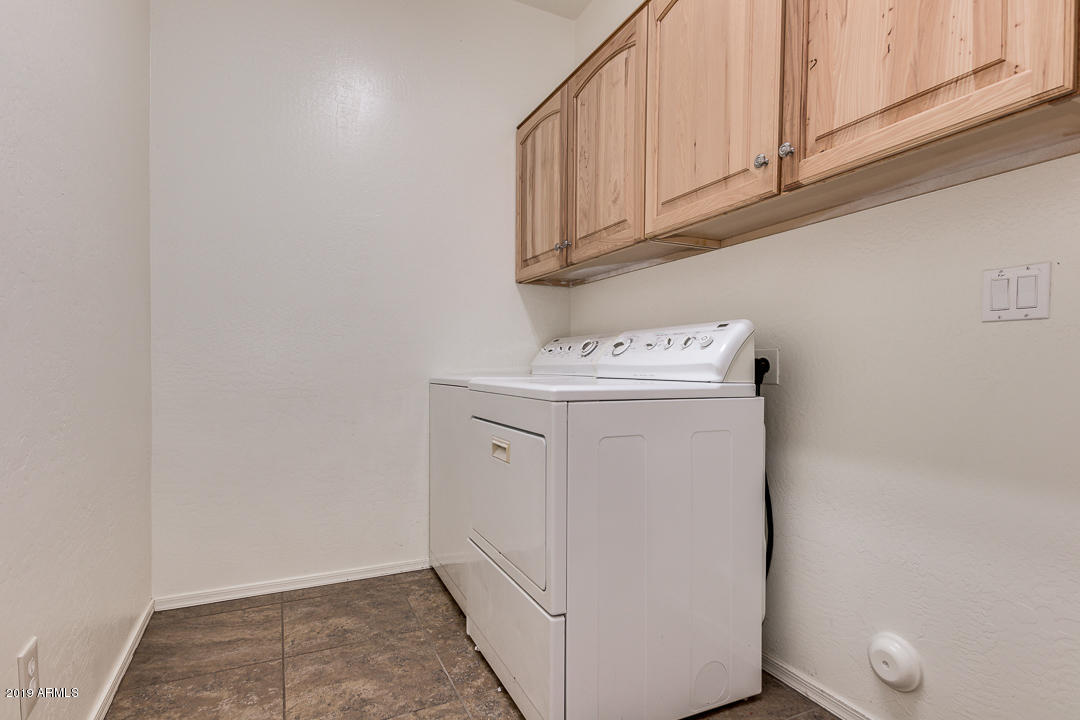 Laundry Room Complete with Cabinets