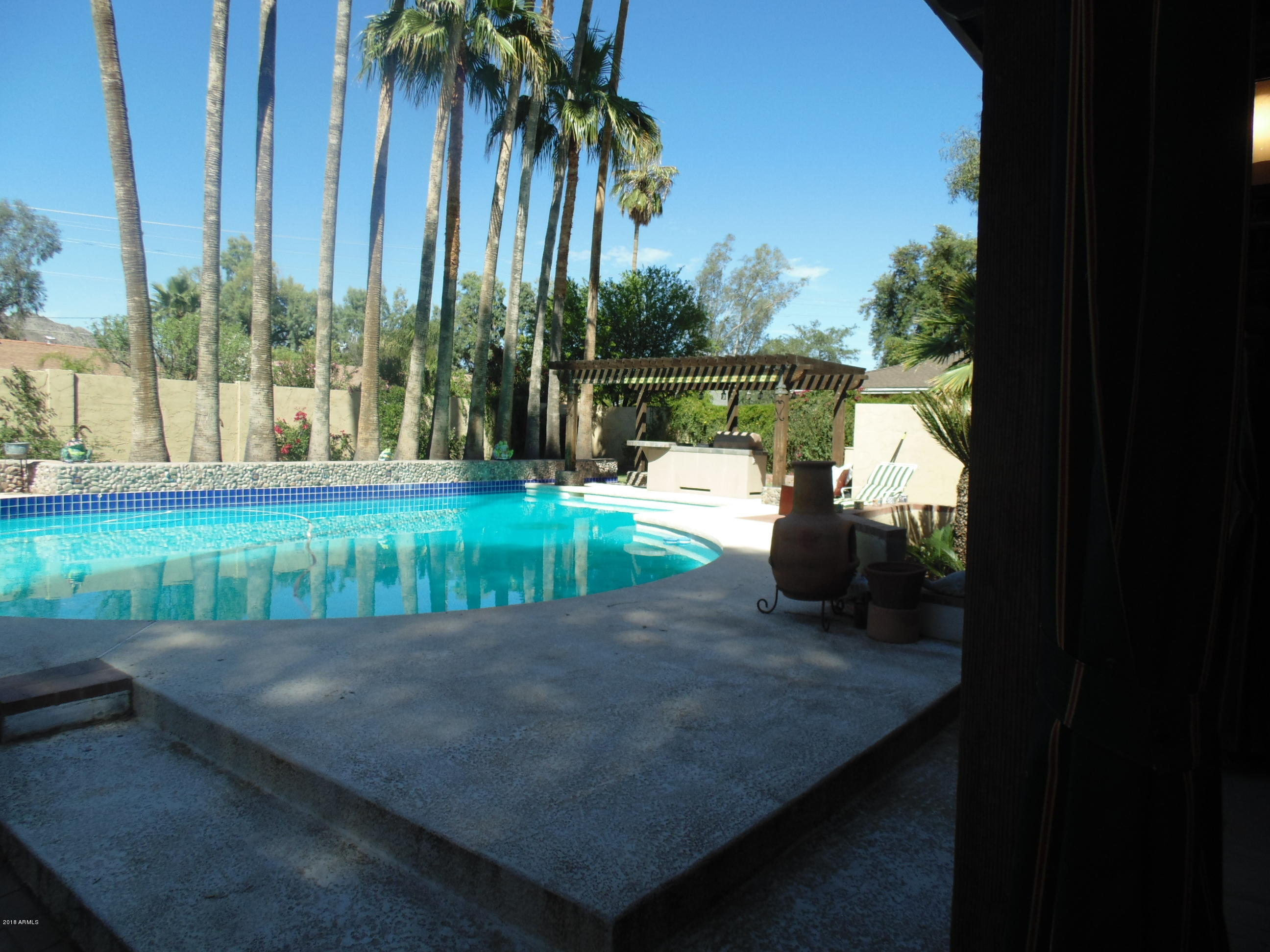 View of pool from covered patio