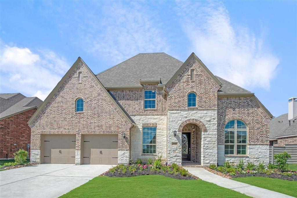 The brick and stone combination make this home stand out!