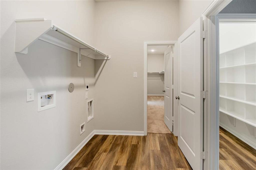 Utility room is connected to master closet- makes laundry days easier!