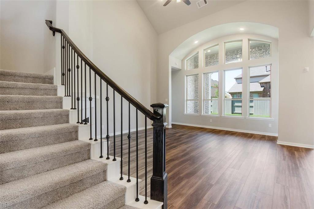Soaring ceilings & tall windows throughout!