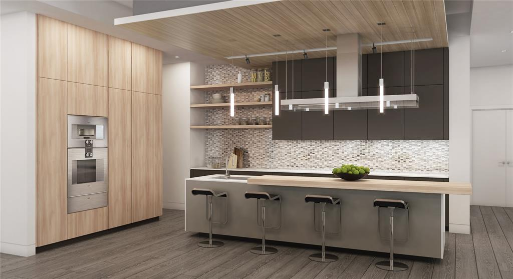 Italian-made kitchen cabinetry by Poliform, Gaggenau appliances including built-in refrigerator and freezer, wall oven, warming drawer, gas cooktop, island hood venting directly to exterior, under-counter lighting and walk-in pantry.