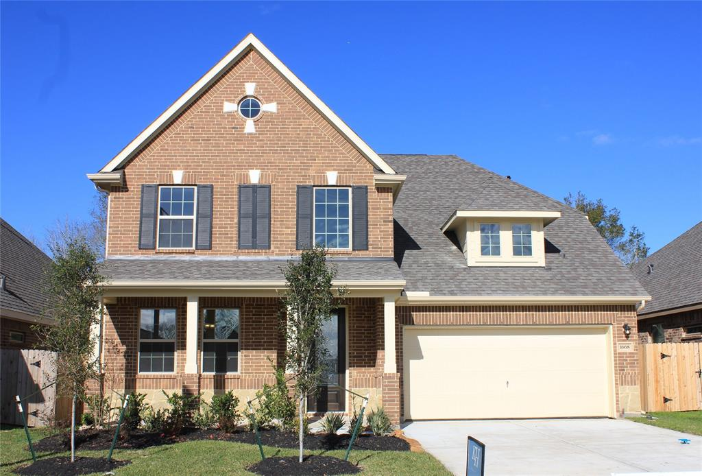 Two-story home with 4 bedrooms, 2.5 baths and 2 car attached garage