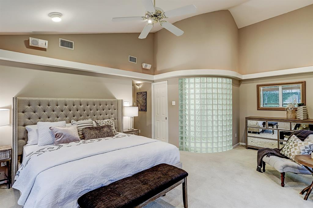 This MASTER BEDROOM has interesting architectural details, neutral carpeting and an en suite bath.