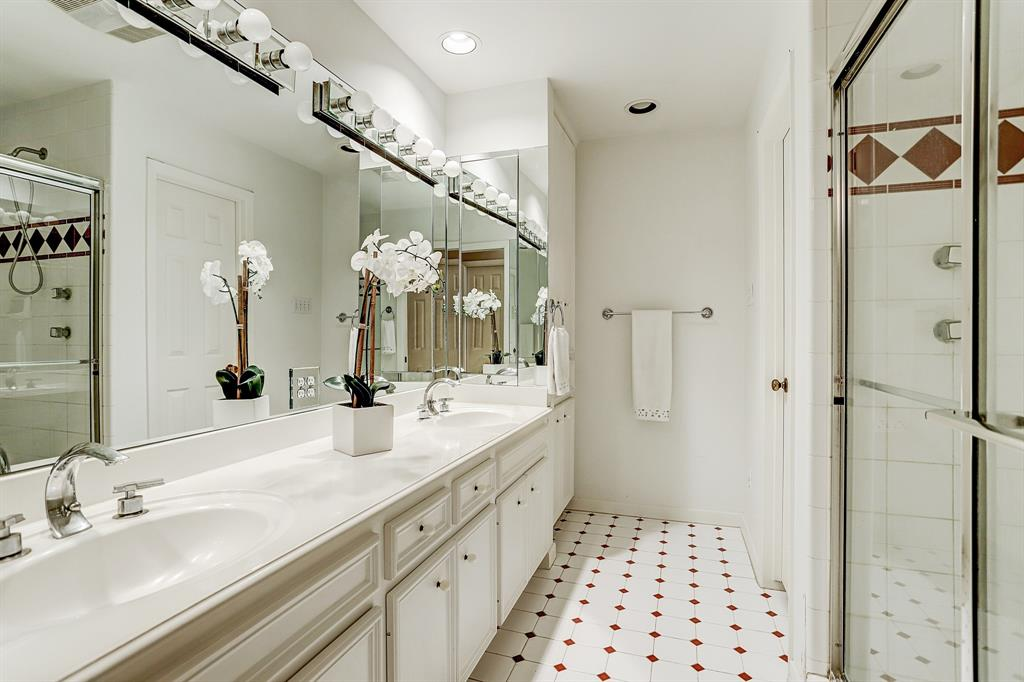 The MASTER BATH has a wide vanity with double sinks, a private water closet and a spacious walk-in shower.