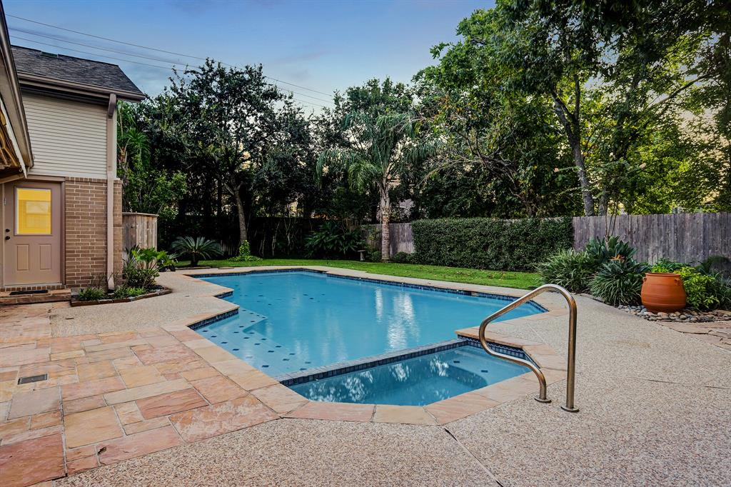The POOL & SPA are surrounded by attractive decking and there is a large retractable awning (barely seen on the left) that creates a spacious poolside covered area on hot days.