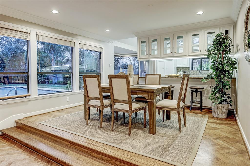 The FORMAL DINING ROOM (14\' x 11\') is open to the Kitchen and the Living Room, and has a continuation of the beautiful oak flooring.