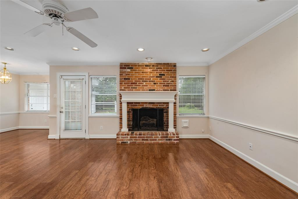 Gas fireplace with custom mantle flanked with windows overlooking the large back yard