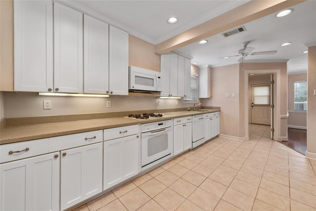 Large kitchen with lots of cabinets and counter top space