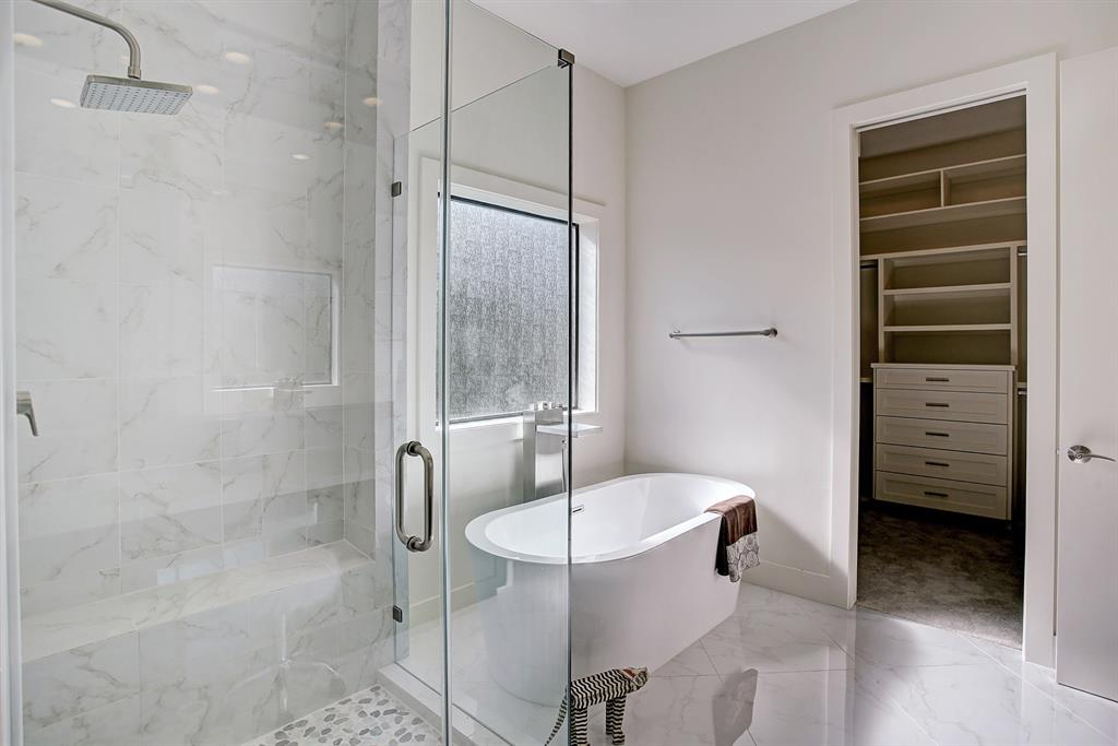 The glass encased shower and soaker tub invites you to relax