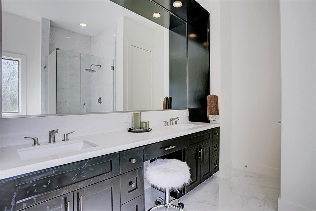Double vanity with lots of storage...beautiful quartz countertops and porcelain tile