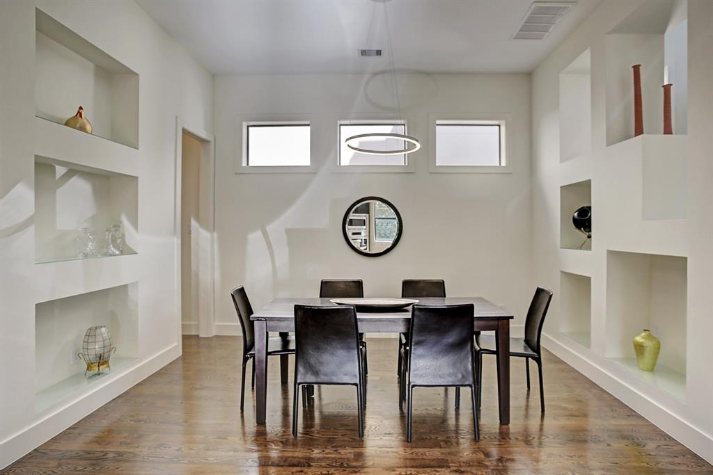 Amazing contemporary dining room with halo chandelier, love all the architectural niches for housing your special treasures