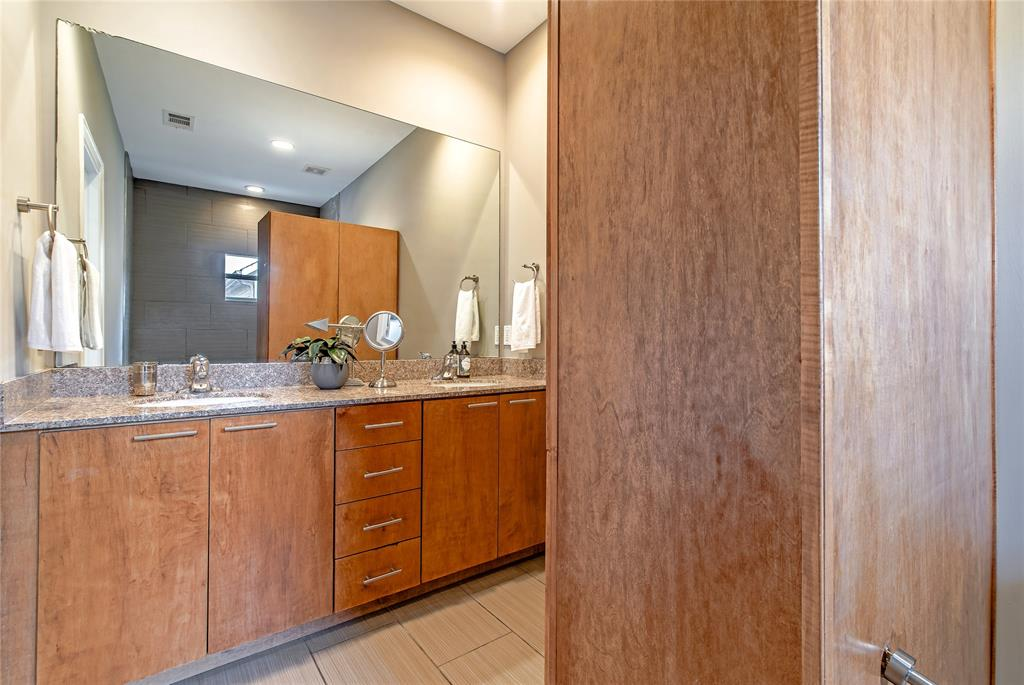 6\' cabinet offers storage and separates shower from vanity area.