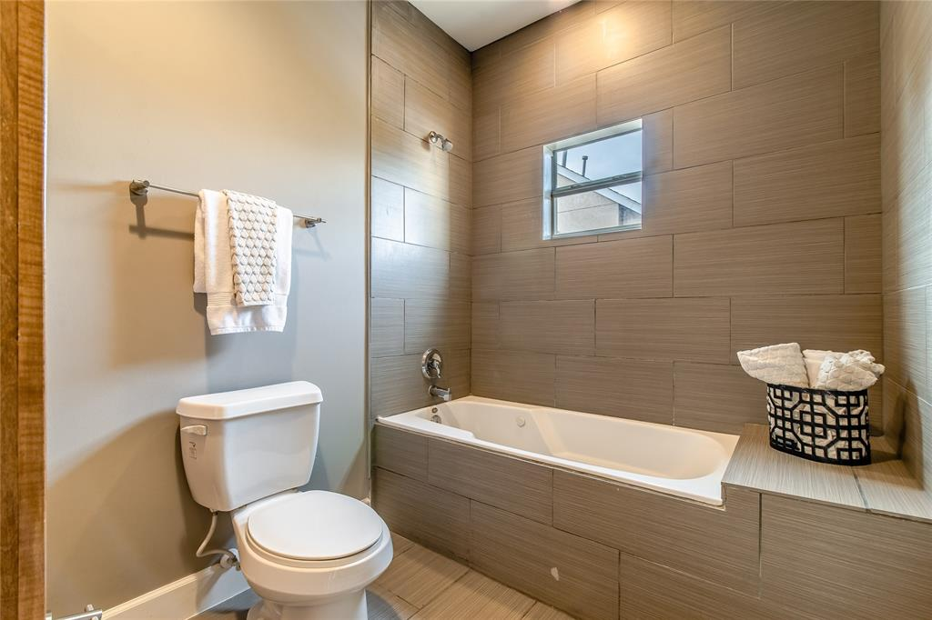 Master bathroom with soaking tub and natural light.