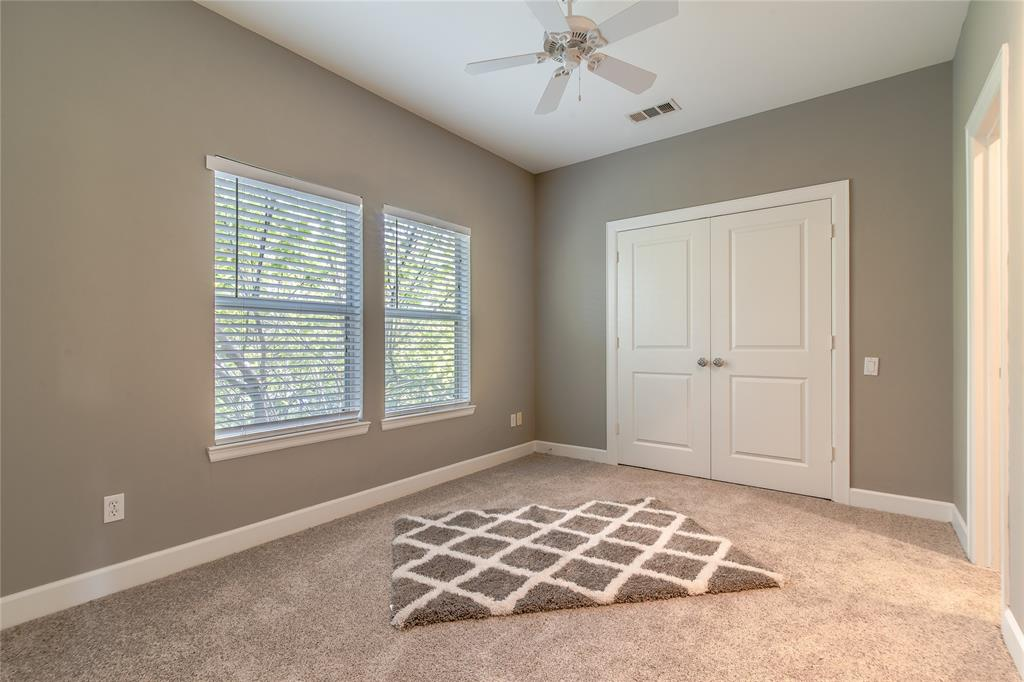 Second bedroom with a new carpet and a good size closet.