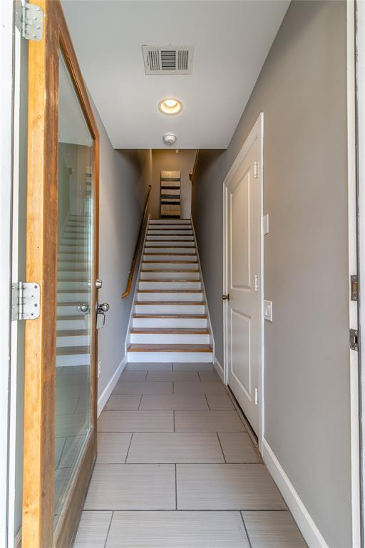 Front entry takes you to second floor living.