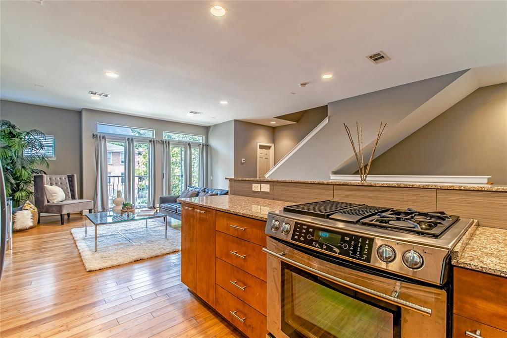 Gas range and stainless steel appliances.