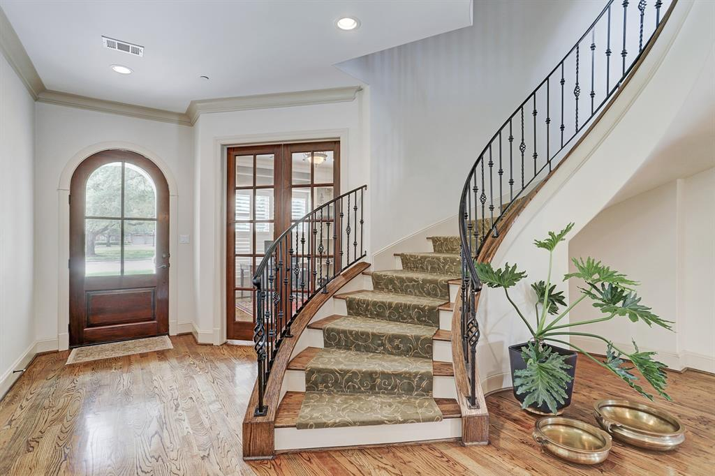 Gorgeous spiral staircase, by the ENTRY and STUDY, leads to 4-bedrooms up plus a 2nd living/play area.  This home is elevator capable!