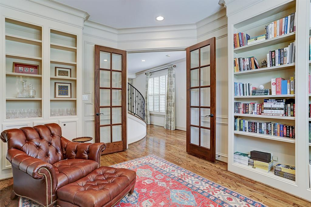 Enter into the 1st floor STUDY - 15x12 - through window-pane double doors.  Fully wood-paneled walls with built-in shelving and cabinetry.