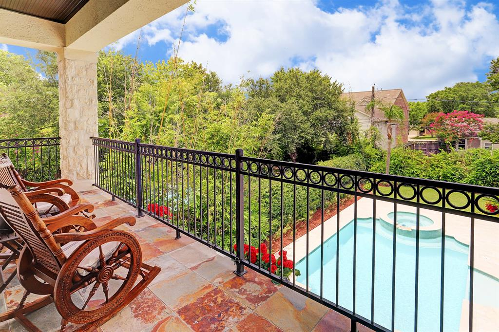 BALCONY off the master with slate deck offers views to the resort-style backyard and sparkling blue pool.  Current owners love to drink tea and relax whether morning or evening.  An extension of the home  -  the yard is secluded on all sides.  Very relaxing!