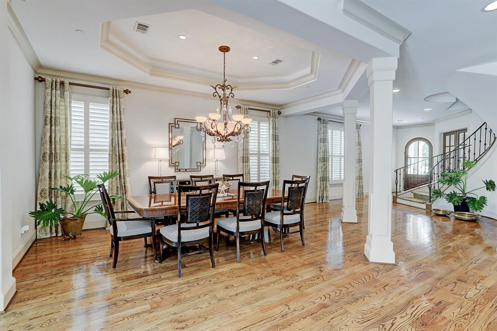 Entertain on a grand scale in the elegant DINING AREA - 18x12 - boasts a tiered ceiling and an alabaster chandelier by designer F Raymond.  Beautiful oak hardwoods throughout the 1st floor.