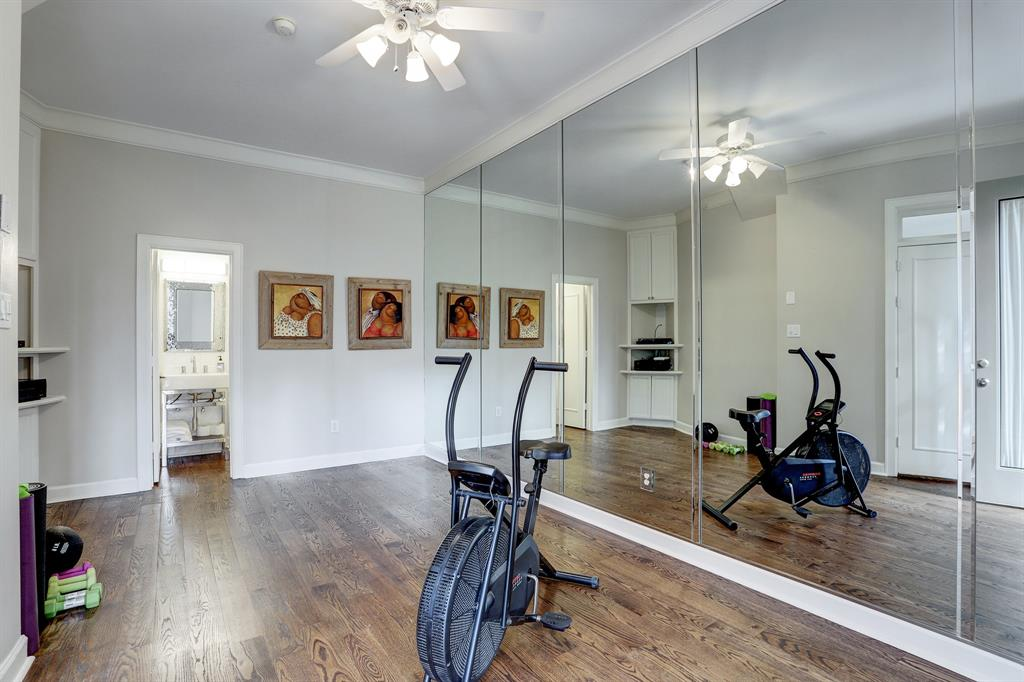Situated off the family room, this flex space has a full bath.  It uis currently being used as an exercise room.