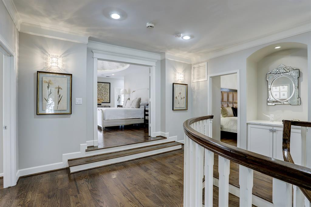 Hardwood floors throughout the second floor. The spacious master is through the double doors in the center.