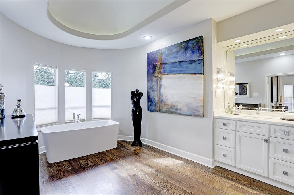 The stunning master bath was updated in 2017 and features Quartz counters, double sinks, soaking tub and glass entry shower.