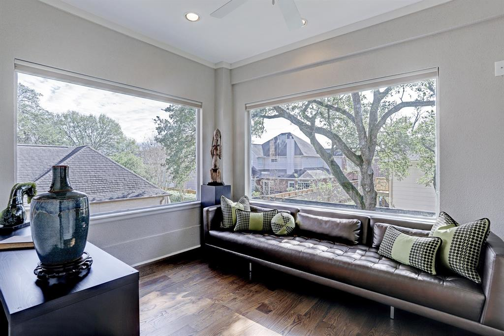 Fabulous bonus room off the master offers lots of natural light and views of the beautiful backyard.