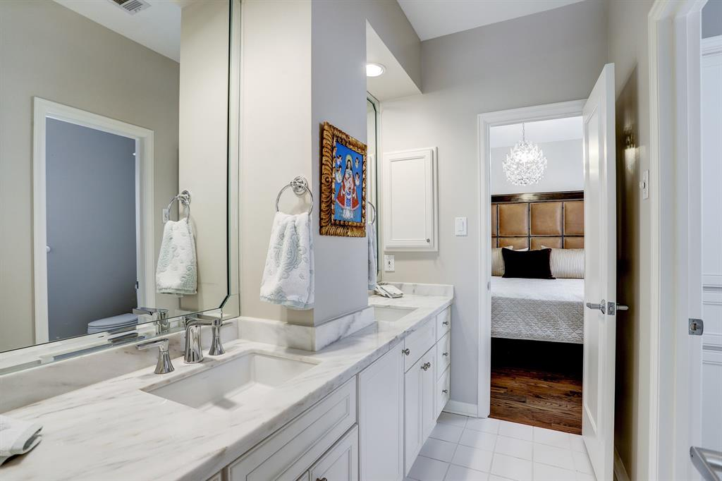 This guest bath was updated in 2017 with Quartz counters, sinks and plumbing fixtures and has double sinks and a separate tub with shower and toilet area.