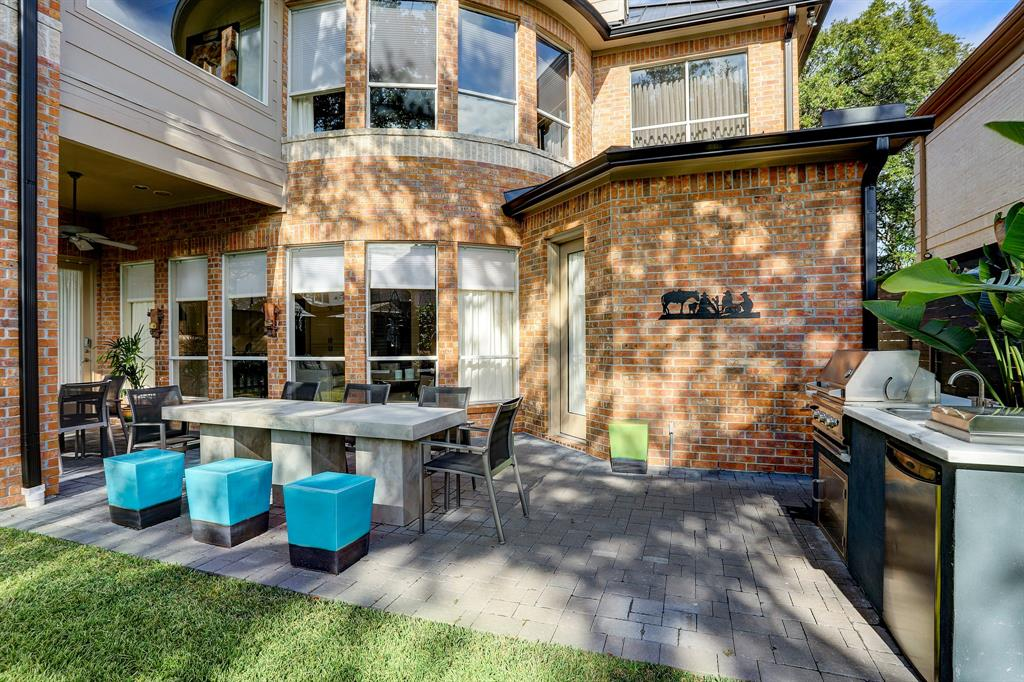 Spacious patio features an outdoor kitchen with sink and grill (2017).