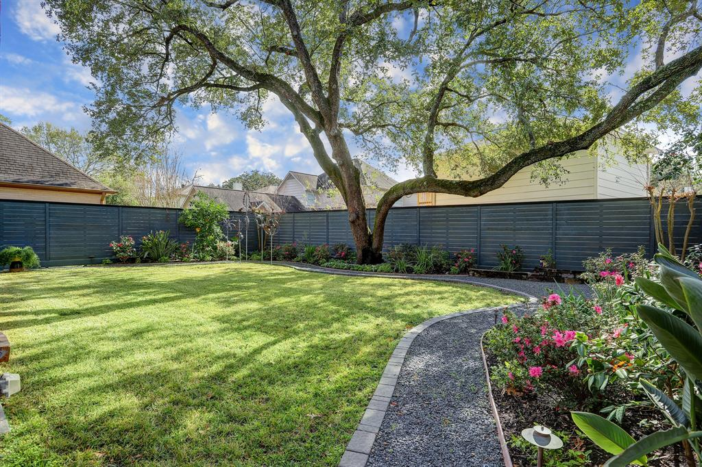 There is extensive landscaping and an 8 ft privacy fence (2018).