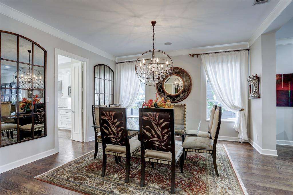 Beautiful formal dining room features a stunning iron and crystal chandelier.