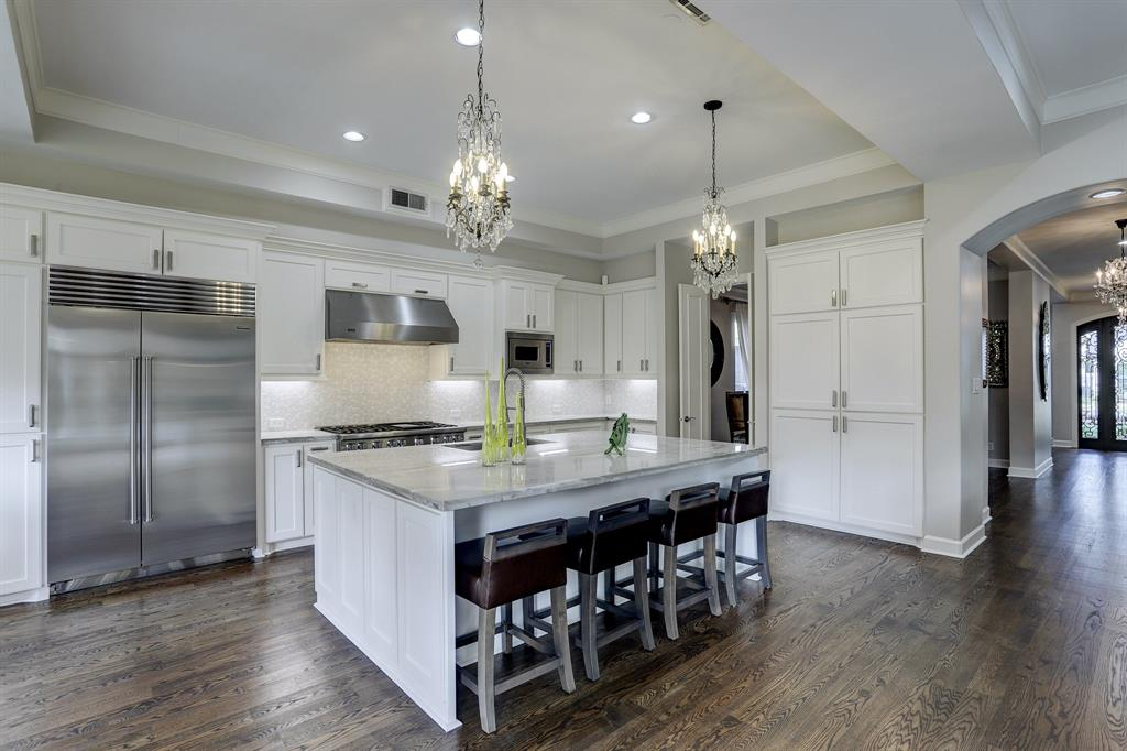 Stunning kitchen updated with Quartz counters, Sub Zero fridge/freezer, Viking professional range with double ovens and a professional vent hood, built-in microwave and dishwasher.
