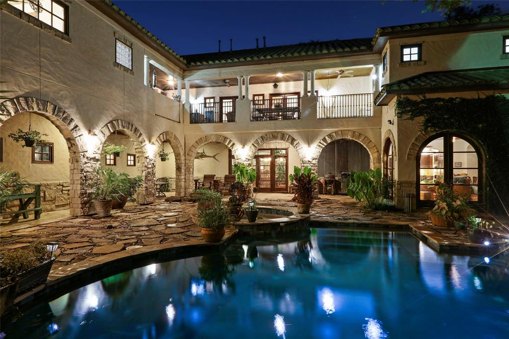 One of a kind luxury Hacienda style residence, with a resort like backyard pool, situated on a rare 18000 sq ft wooded lot in the heart of Bellaire.