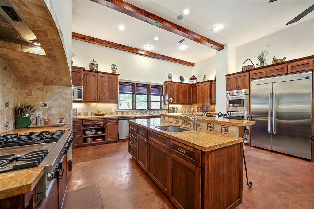 This kitchen offers lots of lighting and a great view of the front yard.