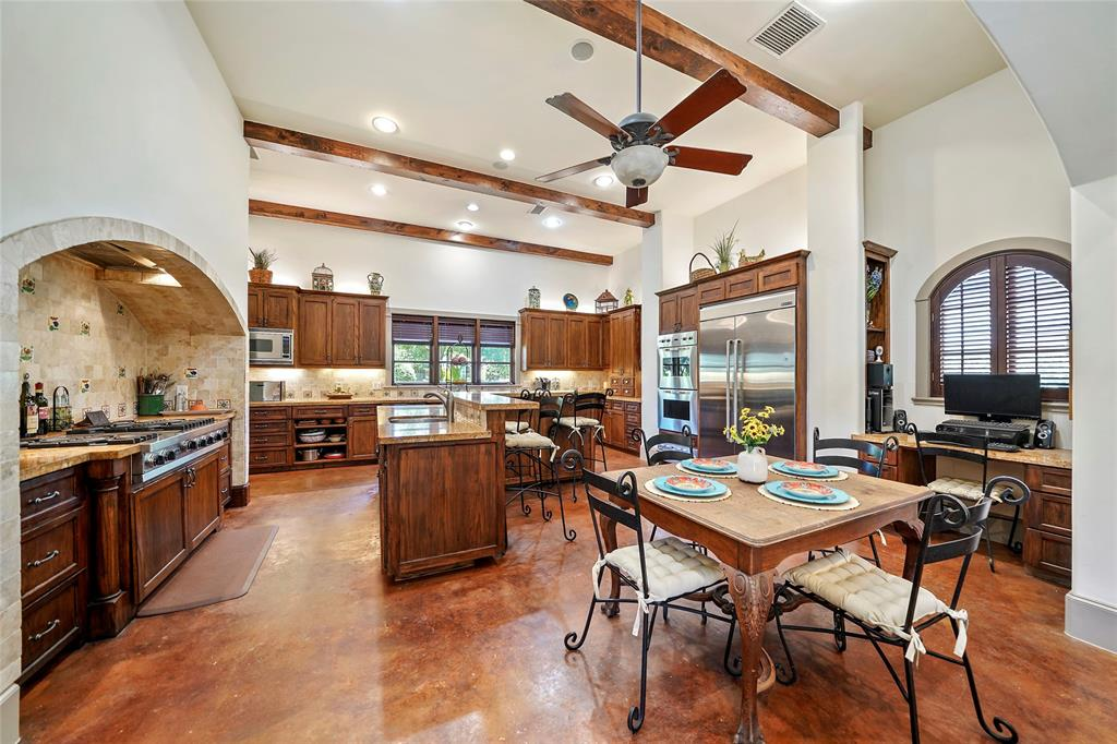 This massive kitchen offers a fabulous preparation and entertaining space for large gatherings.