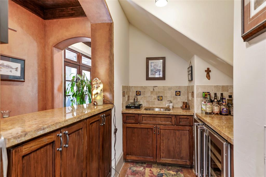 Wet bar off of the Family room and the kitchen features a wine cooler, ice maker and wet sink.