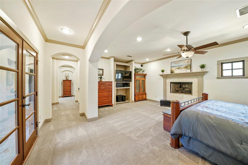 Executive Master suite features wood burning fireplace, new carpet and French doors to upstairs patio.