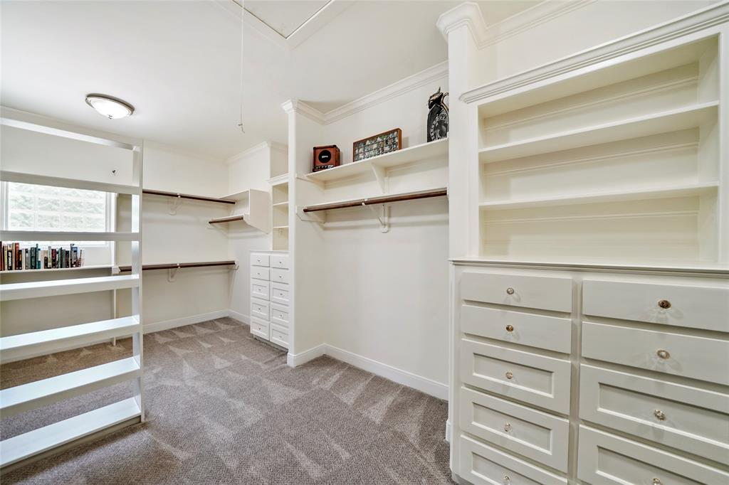 The Master suite features 2 massive closets with built in dressers and shelving. The other closet also features a combo locked safe room with WIFI and a 3rd hidden staircase that leads to the garage.