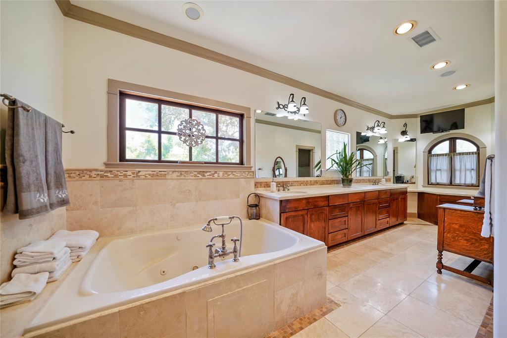 Huge Master Spa Retreat features a double wide spa tub with ample space for two.