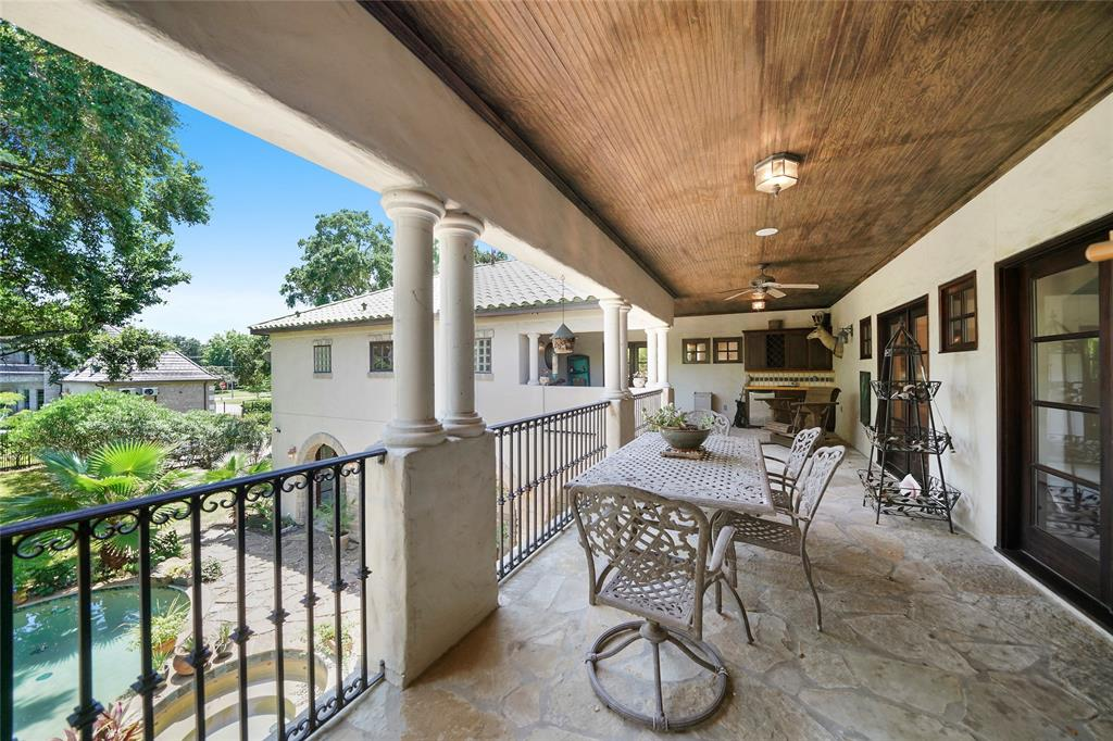 Over 500 square feet of upstairs balcony patio that overlooks the lush pool area below. French doors on the right lead into the upstairs Gameroom. Great secondary entertaining area.