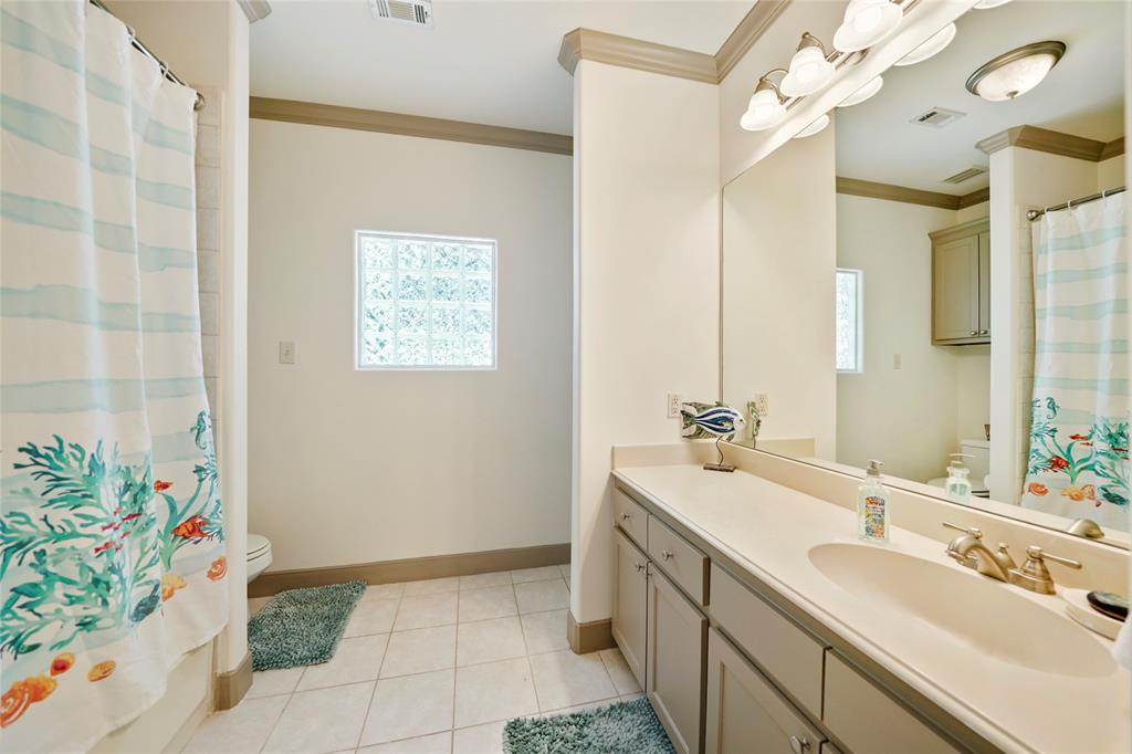 Bedroom 2 Ensuite bathroom features a large vanity sink and a whirlpool/ shower combo.