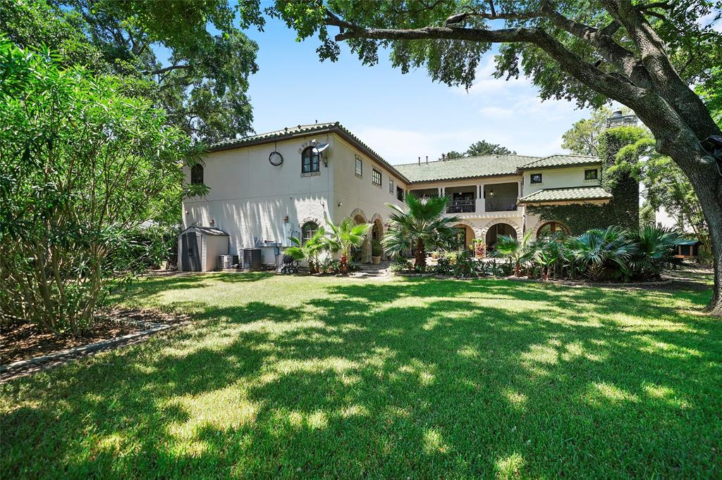 View from back of the massive 18000 sq foot lot that features 4 mature live oaks, rarely seen on one lot in the  Bellaire area.