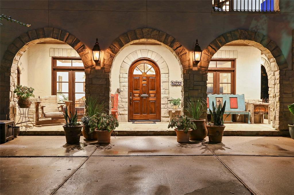 Exterior lighting, huge arching oak trees and the long, doublewide circular driveway create a grand entrance to this one of a kind executive home.