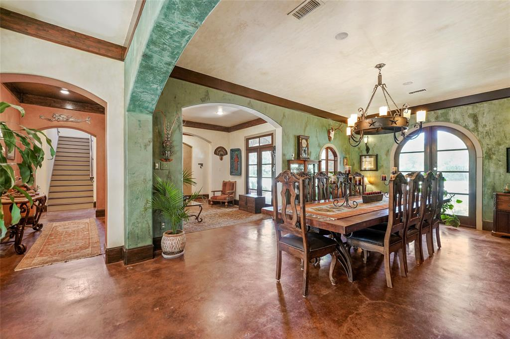 Arches abound throughout the home and low maintenancecustom stained concrete floors are throughout the 1st floor.