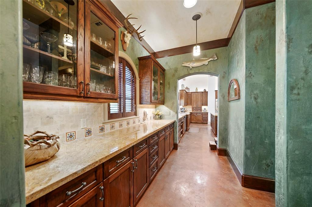 Huge butlers pantry, that connects the dining room with the kitchen and walkin pantry, features loads of storage for your crystal and serving pieces.