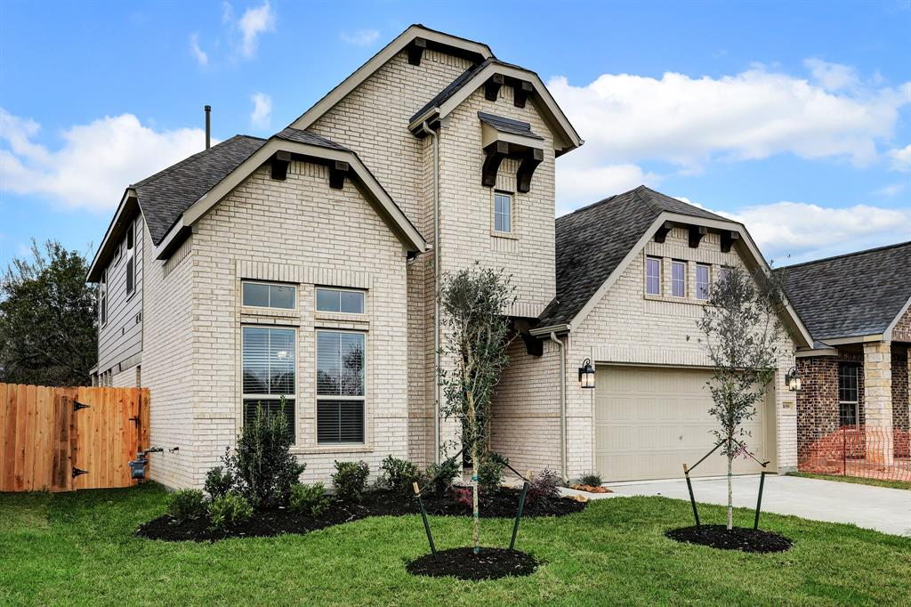 Two-story home with 4 bedrooms, 3.5 baths and 2 car attached garage
