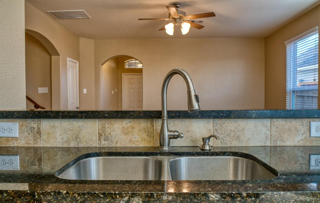 Undermount Sink with Modern Hardware.  View towards the Family Room and Front Entry Door.