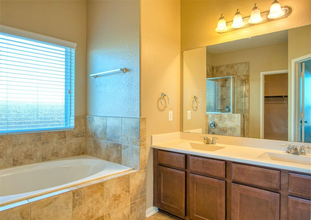 Master Bath features Double-Sinks and a Large Garden Tub with Tile Surround.